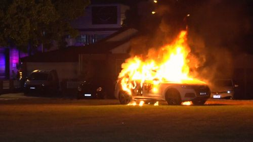 The white Audi was well alight when emergency crews were called to the scene in Five Dock overnight. (9NEWS)