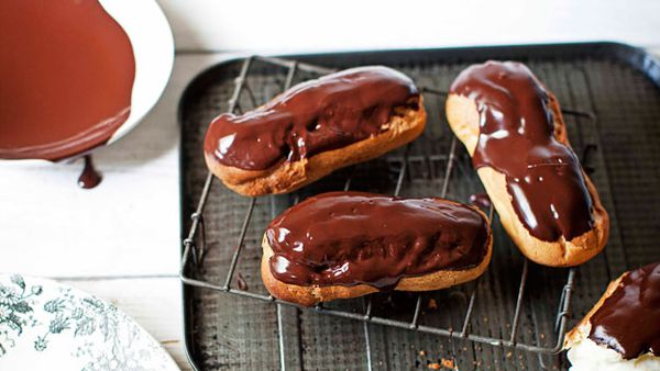 Chocolate eclairs filled with white chocolate cream