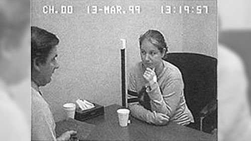 Robertson speaks with police following her arrest in 1999.