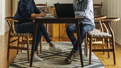 Couple sitting at table working from home
