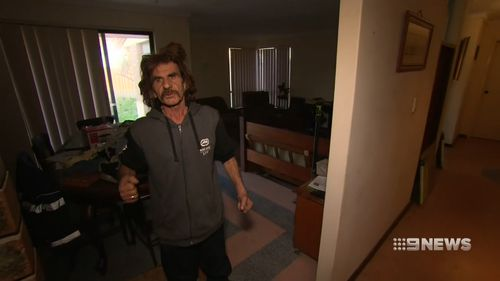 A brave grandfather has fought off an armed intruder in a frightening home invasion in Perth's north-east.