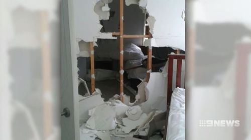 The partygoers destroyed walls in the house.