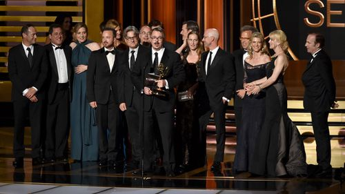 The cast and crew of Breaking Bad accept their award for most outstanding drama.