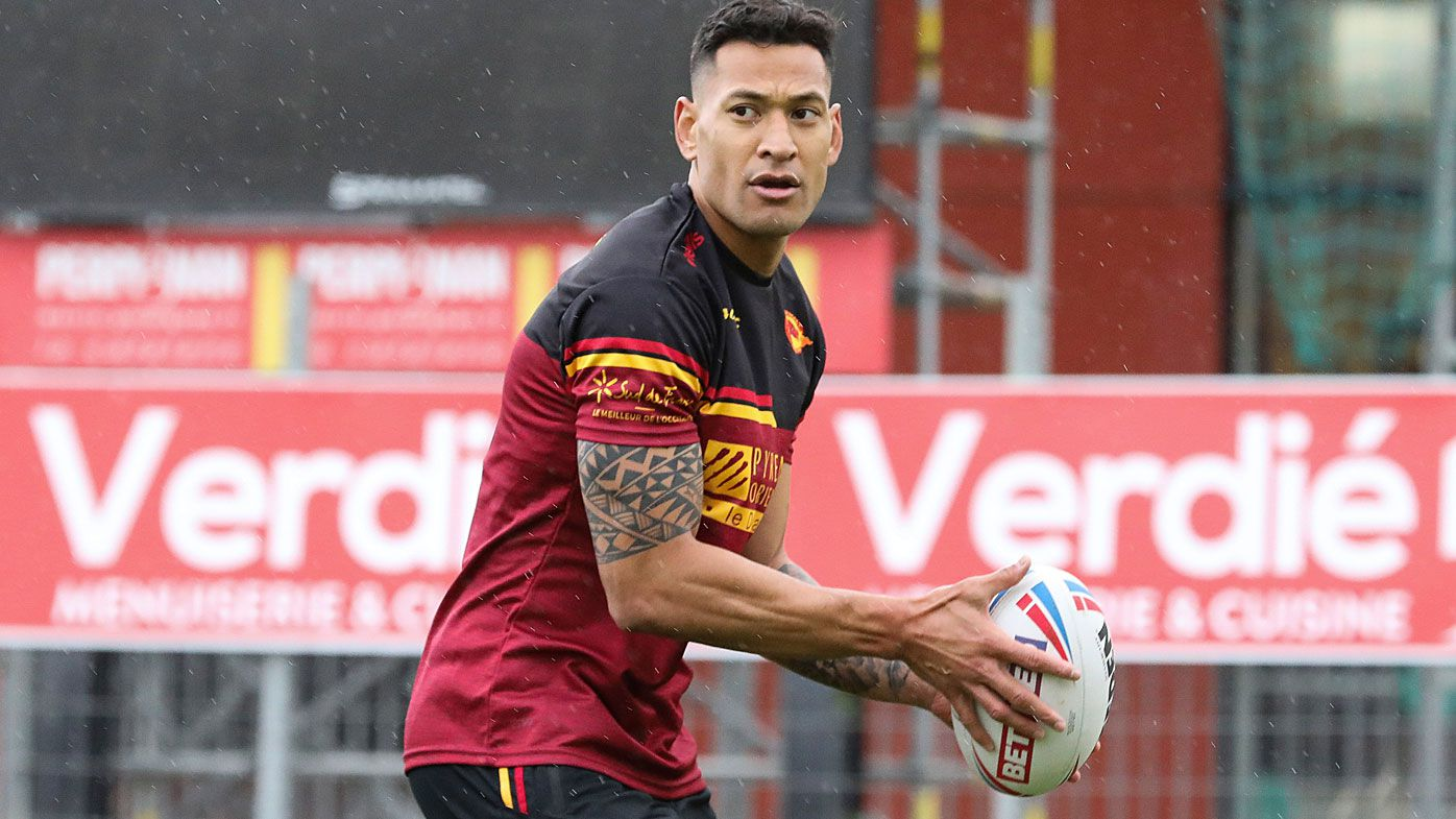 Australian rugby player Israel Folau prepares to pass the ball during a training session with his new club Catalan Dragons in Perpignan