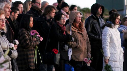 Dozens of family and friends converged for the vigil. (AAP)