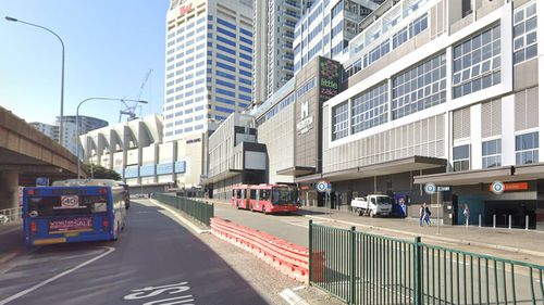 A woman has died after being hit by  a bus at Bondi Junction this morning.