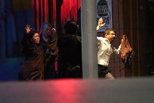 Lindt cafe hostages flee after the siege.