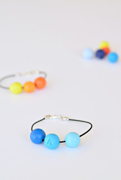 "<p>Alphabet bracelets</p> <p>These darling little bracelets suit boys and girls. Made with clay beads and leather cord, they are a little trickier in the craft stakes - but worth it. You can personalise them with each guest's initial. <a href=""https://yourdiyfamily.com/2016/11/celebrate-friendships-with-these-diy-personalised-bracelets/"" target=""_blank"">Here's how to make them ...</a></p>"