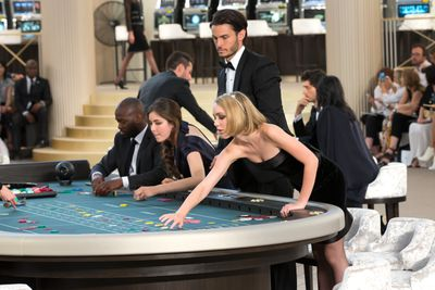 <p>Ever the consummate showman, Karl Lagerfeld created an 80s inspired casino for Chanel's Fall Haute Couture Fall 2015 show. Celebrity guests were seated at tables before models took to the catwalk, blurring the line between runway and front row.<br>&nbsp;</p>