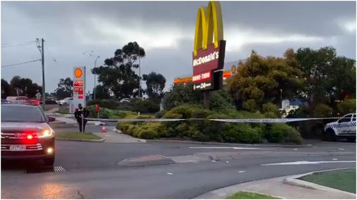 Police were forced to run and seek shelter in a McDonalds restaurant after their car was allegedly shot at and rammed this morning.