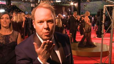 Comedian Peter Helliar from The Project blows a kiss to the camera.
