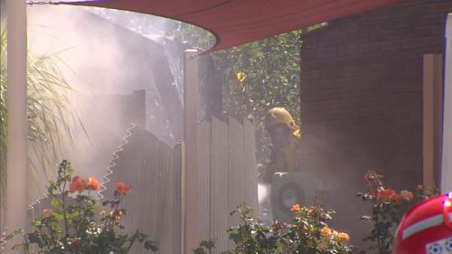 Neighbours also watered down their own homes as the grass and gutters started to catch alight.
