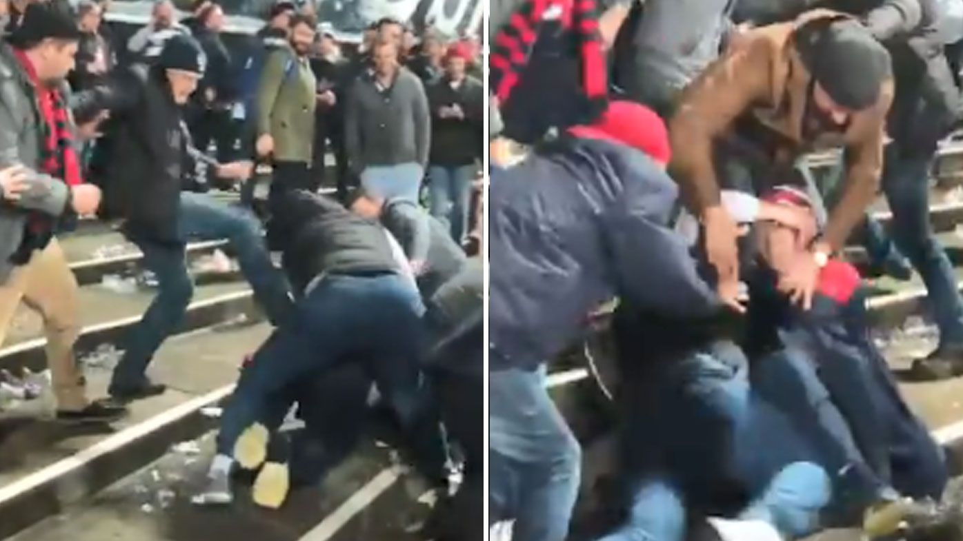 AFL fans caught on video in massive brawl after Geelong's comeback win over the Demons
