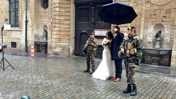 A Belgian couple pose for a wedding photo in the deserted capital Brussels.