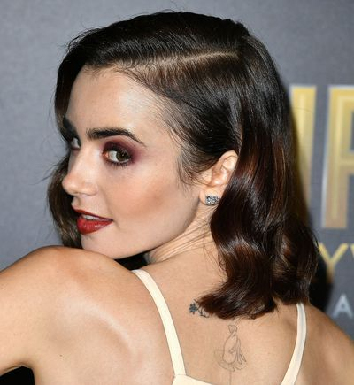 British actress and model, Lily Collins opted to paint her eyes and lips in plummy, reddish shades.