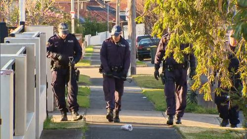Officers at the Kogarah Bay scene today. (9NEWS)