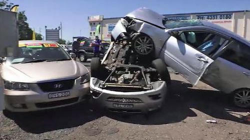 The car ploughed into a number of parked cars in the motor vehicle dealership.