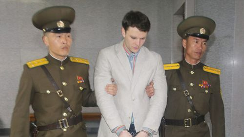 American student Otto Frederick Warmbier (C) arrives at a court for his trial in Pyongyang, on March 16, 2016. (AFP)