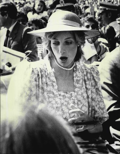 Princess Diana startled when flowers are thrown at her as she leaves the Sydney Opera House.