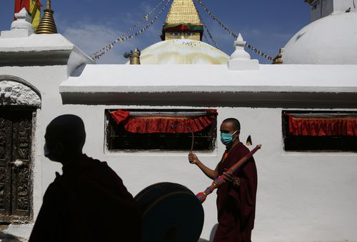 Buddhist monks participate in a parade to mark Buddha Jayanti festival, during lockdown at Boudhanath Stupa in Kathmandu, Nepal