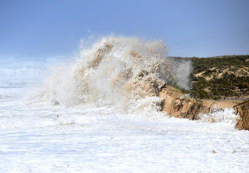 Large waves slam into the beach causing beach erosion on the Sunshine Coast.