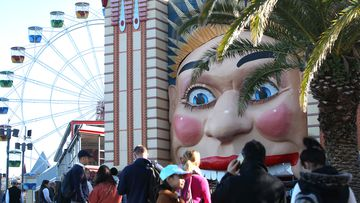 Guests queue to enter Luna Park on  a July day in Sydney, Australia.