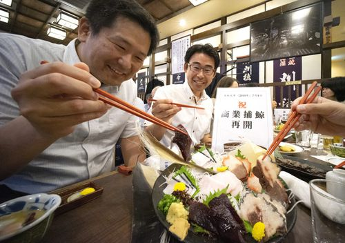 People enjoy eating whale dishes at a restaurant in Tokyo, Japan