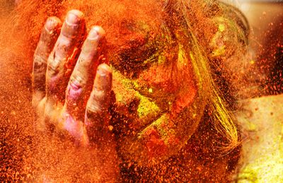 Holi Festival is celebrated by people throwing coloured powder and coloured water at each other.