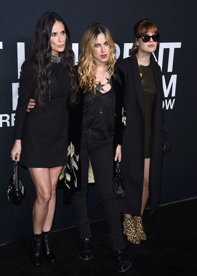 Now: Actress Demi Moore, daughters Scout and Tallulah Willis  at Saint Laurent at the Palladium in 2016 in Los Angeles.