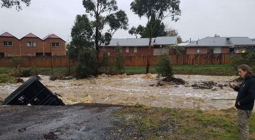 Flood waters damaged homes, businesses and washed cars away.