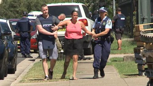 Chantelle Tonna being led away by police.