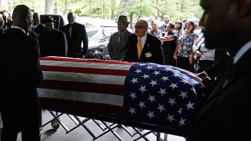 The casket of Walter Scott is taken into the W.O.R.D. Ministries Christian Center in Summerville, South Carolina, for his funeral. (AAP)