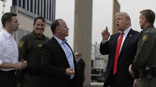 President Donald Trump reviews border wall prototypes, Tuesday, March 13, 2018, in San Diego. (AP)