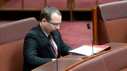 Senator Muir holds a key vote on the government's plan to deregulate university fees. (AAP)