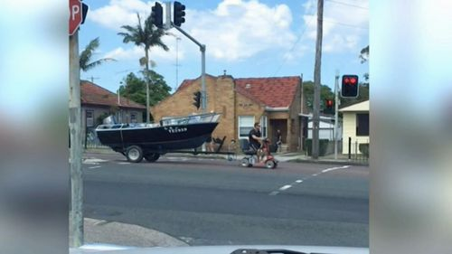 Footage went viral last month showing Shane Swancott riding his mobility scooter down the Pacific Highway with a motorboat in tow.