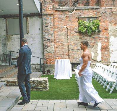 Bride pranks groom with best man wearing a wedding dress