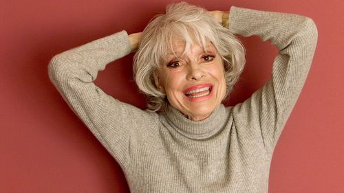 Actress Carol Channing smiles for the camera during an interview at the Beverly Hilton Hotel in Beverly Hills, California, in 2002.