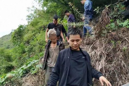 Song Jiang is led down the mountain by Yongshan Police, who captured him after 17 years on the lam.