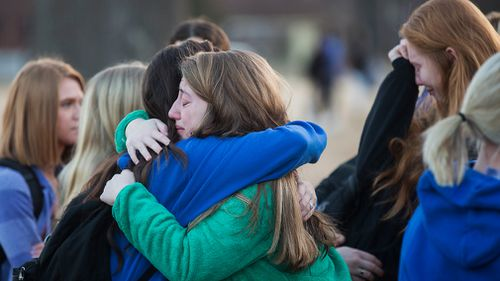Students embrace following a prayer vigil at Paducah Tilghman High School in Paducah, Kentucky. (AAP)