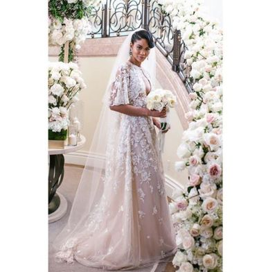 """<p>Not all supermodel weddings involve rock stars, billionaires and hired castles, unless you're Chanel Iman marrying New York Giants player Sterling Shepard.<br> <br> The former Victoria's Secret angel, who has also worked with Burberry, Gucci and Tom Ford, opted for an elegant, lace gown from Zuhair Murad to walk down the aisle in front of the likes of Chrissy Teigen, Jourdan Dunn and stylist Monica Rose.<br> <br> Despite being presented with an array of options by her stylist, Anita Patrickson, the 27-year-old was taken with the ' Camila' gown from the Lebanese designer's A/W'18 collection.<br> <br> """"My stylist ( Patrickson) , really took control and handled dressing the entire wedding party, we've worked together for more than five years, so she has a real understanding of what I gravitate toward,"""" Iman told <a href=""""https://www.vogue.com/article/inside-chanel-iman-final-wedding-dress-fitting-zuhair-murad-sterling-shepard"""" target=""""_blank"""" draggable=""""false"""">US Vogue.</a><br> <br> """"I wanted something that I would like for years to come and that wouldn't feel dated as trends change,""""<br> <br> The body-hugging gown also featured a bolero, made from silk tulle embroidered with sparkling 3-D floral appliqués, which took more than 100 hours to create.<br> <br> """"It's a lovely bridal accent that provides today's modern bride with an alternative accessory,"""" noted Murad.</p> <p>Thankfully for us, the model has taken to her <a href=""""https://www.instagram.com/chaneliman/"""" target=""""_blank"""" draggable=""""false"""">official Instagram account</a> to share all the candid moments from her special day with her 1.5 million followers.<br> <br> Click through to see more of Chanel Iman's intimate wedding day here.</p>"""