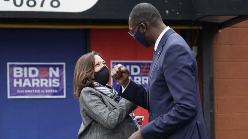 Vice Presidential candidate Kamala Harris greets Michigan's Lt Governor Garlin Gilchrist in Detroit.