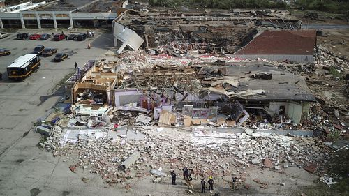 The Northridge Shopping Center on N. Dixie Highway in Dayton, Ohio lies in shambles after a tornado struck.
