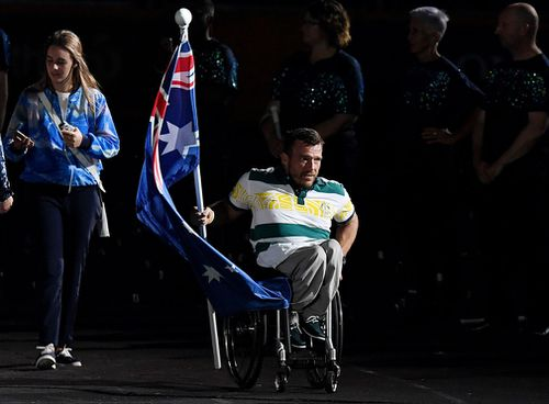 Australian flag bearer Kurt Fearnley received a rousing ovation - but viewers at home missed out on the chance to see him. (AAP)