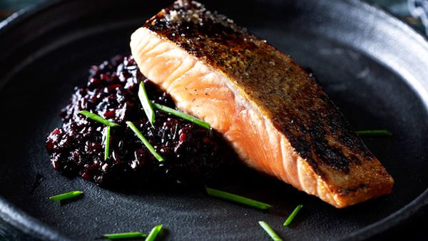 Janet DeNeefe's black rice risotto and salmon (Image: Mark Roper)
