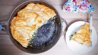 A spinach pie in a pan makes the perfect lazy dinner that still looks so good