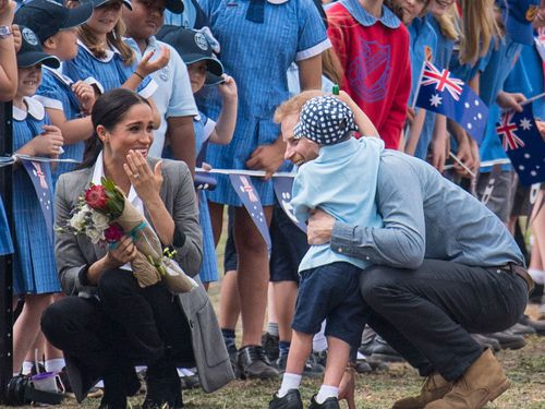 He then went over to give Meghan a hug too.