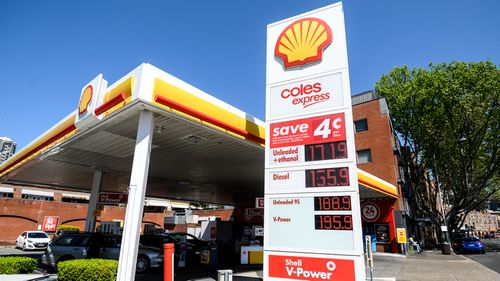 An electronic sign displays petrol prices at a Shell service station in Sydney