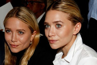 Mary-Kate Olsen and Ashley Olsen pose at the J. Mendel Spring 2012 show during Fashion Week in New York.