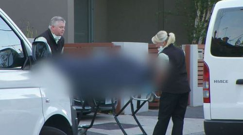 Ms Gatt's body is removed from the home. (9NEWS)