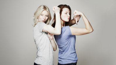 Women flexing their arm muscles